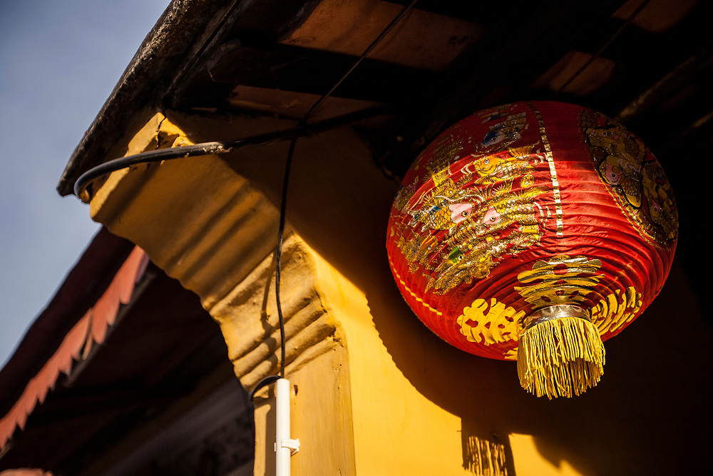 A detail of a traditional paper lantern hanging from a home in the old town of Hoi An, Vietnam. Hoi An is a UNESCO-recognized World Heritage Site, and a popular tourist destination in Vietnam.