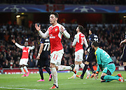 Arsenal midfielder Mesut Ozil missing a chance during the Champions League match between Arsenal and Dinamo Zagreb at the Emirates Stadium, London, England on 24 November 2015. Photo by Matthew Redman.