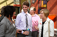 (from left) Kristen Bayliff of the Better Business Bureau, Dan Hoelting of the BBB, Janette Dwyasuk of Ferguson Construction Company and Debby Sibert of WCH Marketing Communications during a BBB/Women in Business Networking event in the atrium of the Kuhn Building in downtown Dayton, Thursday, July 14, 2011.