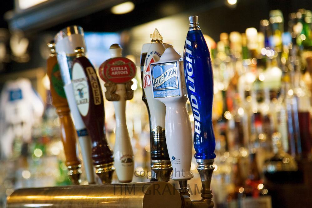 Beer taps in Georgetown bar, Washington DC, USA