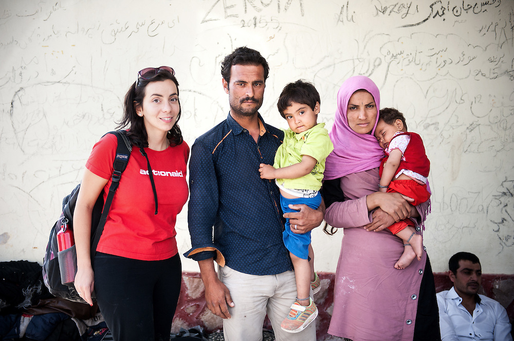 Hara Tasoglou, head of communications of ActionAid Hellas with Bashir 29 holding his daughter Zaahra 2 ½ years old and his wife  Shefqe 24 years old holding her 7 months old girl Hamid from Chardere district of Afghanistan in Moria camp, Lesvos, Greece