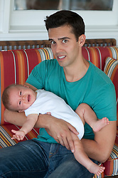 Young man unsure of how to take care of a crying baby