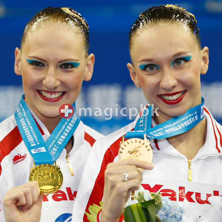 Winners Natalia Ishchenko (R) and Svetlana Romashina of Russia pose with their medals after competing in the Synchronized (synchronised) Swimming Technical Duets Final round during the 14th FINA World Aquatics Championships at the Oriental Sports Center in Shanghai, China, Monday, July 18, 2011. (Photo by Patrick B. Kraemer / MAGICPBK)