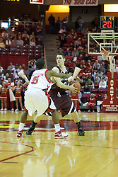 "29 December 2006: Keith ""Boo"" Richardson stops Brian Mullins outside the 3 point arc. The Salukis of Southern Illinois University beat the Redbirds 68-49 at Redbird Arena in Normal Illinois on the campus of Illinois State University.<br />"