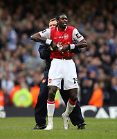Photo: Rich Eaton.<br /> <br /> Chelsea v Arsenal. Carling Cup Final. 25/02/2007. Emmanuel Adebayor of Arsenal has to be restrained and led from the ptich after being given a red card