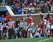 Mississippi wide receiver Donte Moncrief (12) scores on a 52 yard pass play vs. Arkansas at Vaught-Hemingway Stadium in Oxford, Miss. on Saturday, November 9, 2013. Mississippi won 34-24. (AP Photo/Oxford Eagle, Bruce Newman)