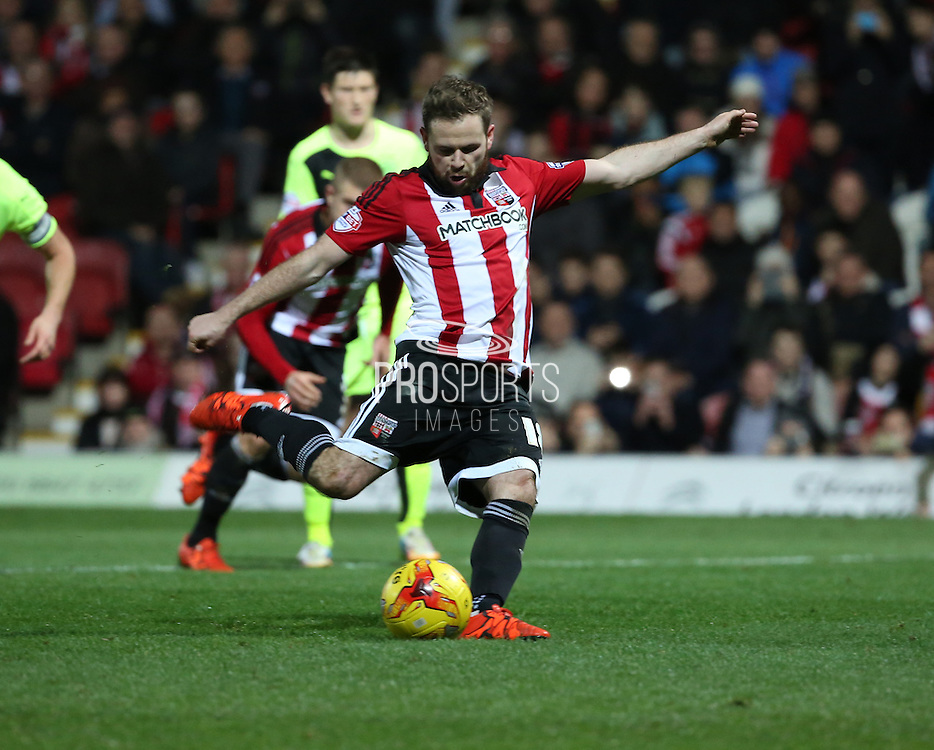 Brentford midfielder Alan Judge scoring a penalty and Brentford fourth goal during the Sky Bet Championship match between Brentford and Huddersfield Town at Griffin Park, London, England on 19 December 2015. Photo by Matthew Redman.
