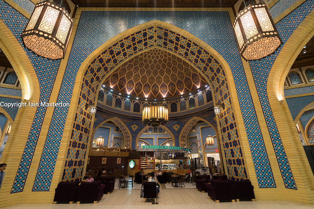 Starbucks coffee shop in ornate atrium at Ibn Battuta shopping mall in Dubai United Arab Emirates