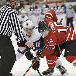 WELLINGTON, - Dec 11, 2015 -  Exhibition Game 2- Team Canada East vs Team USA at the 2015 World Junior A Challenge at the Wellington District Community Centre, ON. Rem Pitlick #16 of Team United States battles for the puck with Makail Parker #16 of Team Canada East during the first period. (Photo: Andy Corneau / OJHL Images)