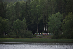 The peloton speed along forest lined shores at Ladies Tour of Norway 2018 Stage 2, a 127.7 km road race from Fredrikstad to Sarpsborg, Norway on August 18, 2018. Photo by Sean Robinson/velofocus.com