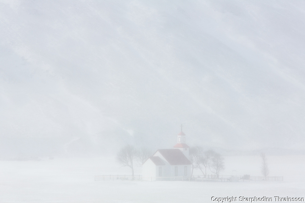 February 04 - Bólstaðarhlíðarkirkja is an old church in Svartárdalur, built in the year 1889, seen here during a winter storm passing by.<br />