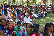 Afro-Sri Lankan Markus Michael (centre) watches the performance with a large crowd of people from throughout Puttalam town.<br /> <br /> After Sunday Mass at St Mary's Church on September 24th 2017, the 500 year celebrations began with the main event being a theatre and musical performance in the afternoon. The date of the event was decided by them and roughly relates to the time they believe the first African slaves were brought to the Island by the Portuguese at the beginning of the 16th Century. <br /> <br /> Out of all communities of African diaspora that surround the Indian Ocean those of Sri Lanka are by far the smallest and most fragile, first brought by the Portuguese, the Dutch and eventually the British as slaves.<br /> <br /> After the Abolition of the Slave Trade Act was passed in the British Parliament in 1807, the process of putting an end to slavery began in British controlled countries. On being emancipated most Africans stayed and a century ago the Afro-Sri Lankan population was believed to be around 6000 people. Today that number has dwindled to less than 500 and are likely to totally disappear in a few generations.