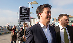 © Licensed to London News Pictures.01/03/2014. LONDON, UK (L-R) Ed Miliband, leader of the Labour Party and  Iain McNicol, General Secretary of his party, arrive followed by protesters . The Labour Party Special conference today at Excel London on 1st March 2014.  Photo credit : Stephen Simpson/LNP