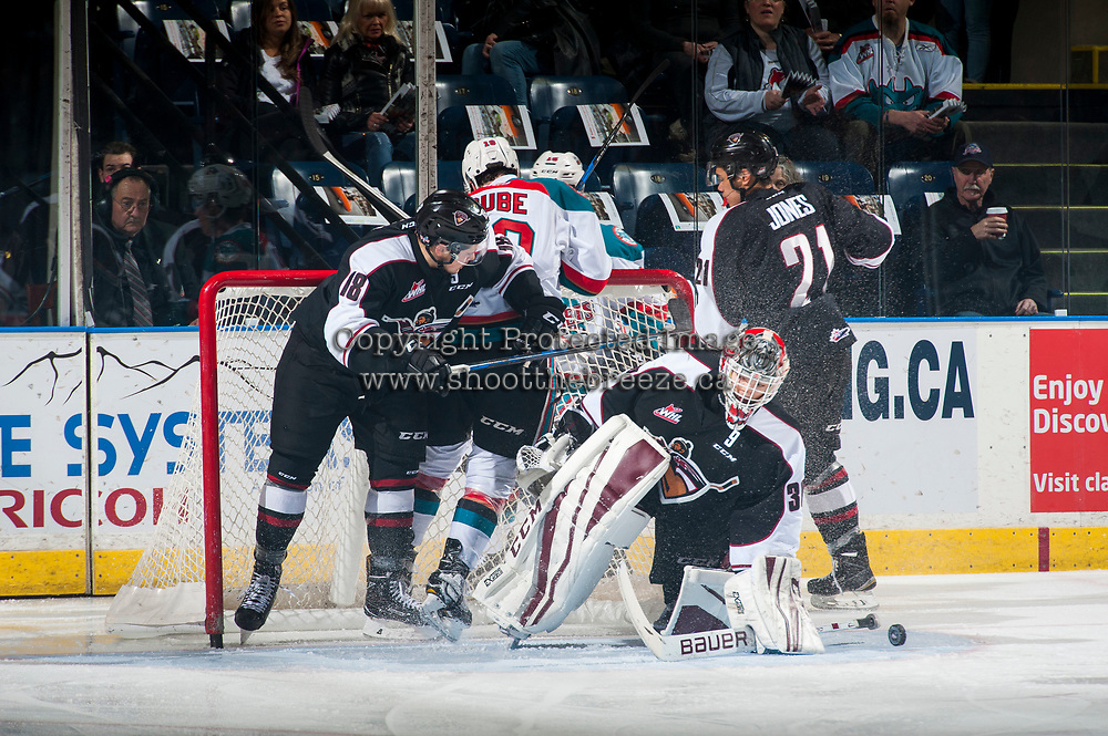 KELOWNA, CANADA - MARCH 10: Dillon Dube #19 of the Kelowna Rockets is checked by Jack Flaman #18 into the net of David Tendeck #30 of the Vancouver Giants  by  on March 10, 2017 at Prospera Place in Kelowna, British Columbia, Canada.  (Photo by Marissa Baecker/Shoot the Breeze)  *** Local Caption ***