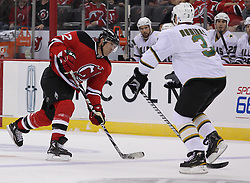 Oct 8; Newark, NJ, USA; New Jersey Devils left winger Brian Rolston (12) takes a shot while Dallas Stars defenseman Stephane Robidas (3) defends during the first period at the Prudential Center.