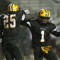 Ripley's Antwon Knox, right, celebrates with teammate Tino Rainer after Rainer recovered a fumble during Friday night's game against New Albany.