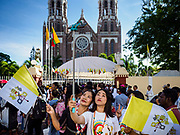30 NOVEMBER 2017 - YANGON, MYANMAR: Women take selfies in front of St Mary's Cathedral before the Papal Mass at St. Mary's Cathedral in Yangon. Thursday's mass was his last public appearance in Myanmar. From Myanmar the Pope went on to neighboring Bangladesh.   PHOTO BY JACK KURTZ