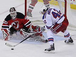 Mar 25, 2010; Newark, NJ, USA; New York Rangers center Artem Anisimov (42) scores a goal past New Jersey Devils goalie Martin Brodeur (30) during the third period at the Prudential Center. The Rangers won 4-3 in an overtime shootout.