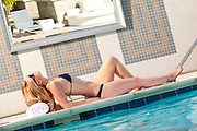 Pretty Blonde Arching Back At Poolside