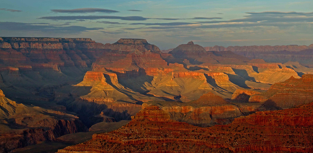 The sun sets over the Grand Canyon as viewed from Yavapai Point. The Grand Canyon is not the deepest or widest canyon in the world, but it's known for its overwhelming size and  intricate and colorful landscape.