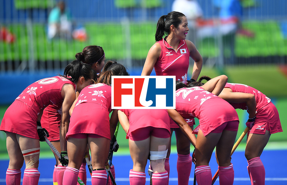 Japan's Mayumi Ono (C) stands as the team meets during the women's field hockey Japan vs India match of the Rio 2016 Olympics Games at the Olympic Hockey Centre in Rio de Janeiro on August, 7 2016. / AFP / MANAN VATSYAYANA        (Photo credit should read MANAN VATSYAYANA/AFP/Getty Images)