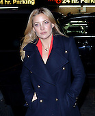Actress Kate Hudson keeps warm in a military style coat