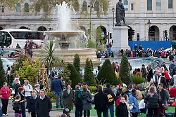 © licensed to London News Pictures. London, UK 21/04/2012. People fill Trafalgar Square as the London landmark transformed into an English garden ahead of St George's Day. Photo credit: Tolga Akmen/LNP