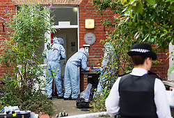 © Licensed to London News Pictures. 27/07/2015. London, UK. Police and scene of crime officers at Colette House in Acton, West London, where the body of a woman in her 30s was found this morning (Mon). Police are currently searching for Michael Meanza  aged 47 in connection work the death.  Photo credit: Ben Cawthra/LNP