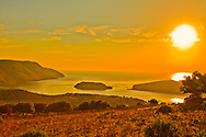 As the sun started to rise, the golden orange haze engulfed Spinalonga in Plaka, Crete Greece.