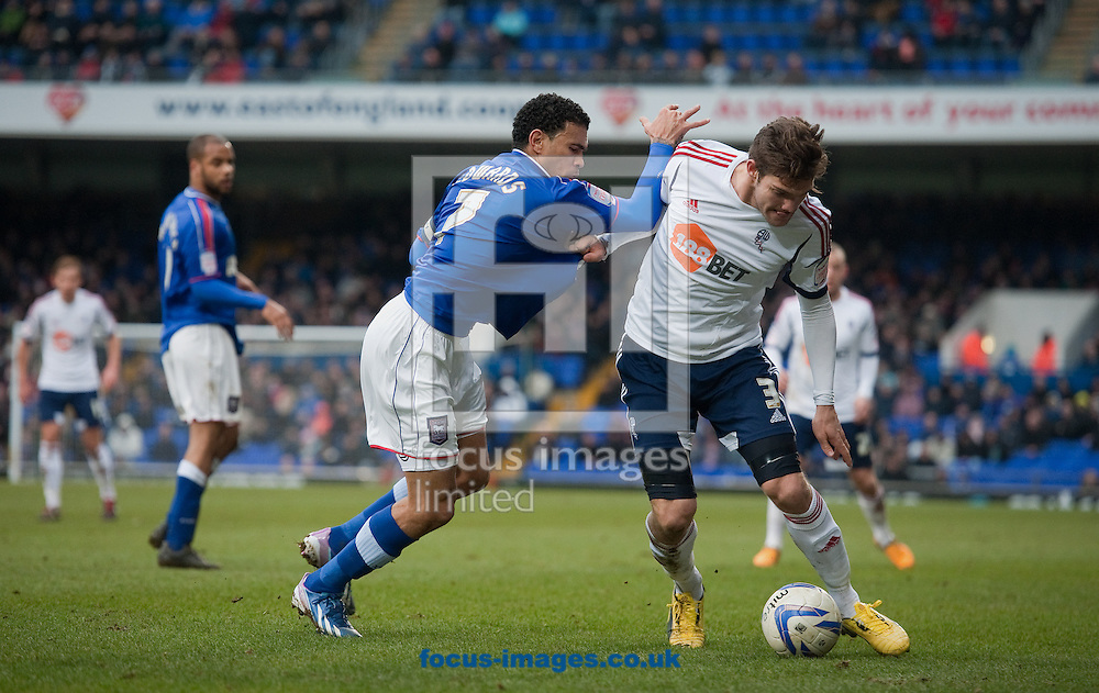 Picture by Will Oliver/Focus Images Ltd 075966707272.16/03/2013.Carlos Edwards of Ipswich Town and Marcos Alonso of Bolton Wanderers at the npower Championship match at Portman Road, Ipswich.