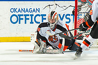 KELOWNA, BC - NOVEMBER 8:  Mads Søgaard #30 of the Medicine Hat Tigers makes a save on a shot by Kaedan Korczak #6 of the Kelowna Rockets during the first period at Prospera Place on November 8, 2019 in Kelowna, Canada. (Photo by Marissa Baecker/Shoot the Breeze)