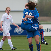 21120413 - IEPER, BELGIUM : Iceland's  Sandra Jessen (16)  celebrates her goal with teammate Svava Gudmundsdóttir (9)   during the Second qualifying round of U17 Women Championship between England and Iceland on Friday April 13th, 2012 in Ieper, Belgium.