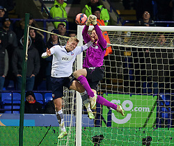BOLTON, ENGLAND - Wednesday, February 4, 2015: Liverpool's goalkeeper Simon Mignolet and Bolton Wanderers' Dean Moxey during the FA Cup 4th Round Replay match at the Reebok Stadium. (Pic by David Rawcliffe/Propaganda)
