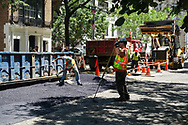 Street crew at work on East 80th street between Park Ave and Lexington Ave.