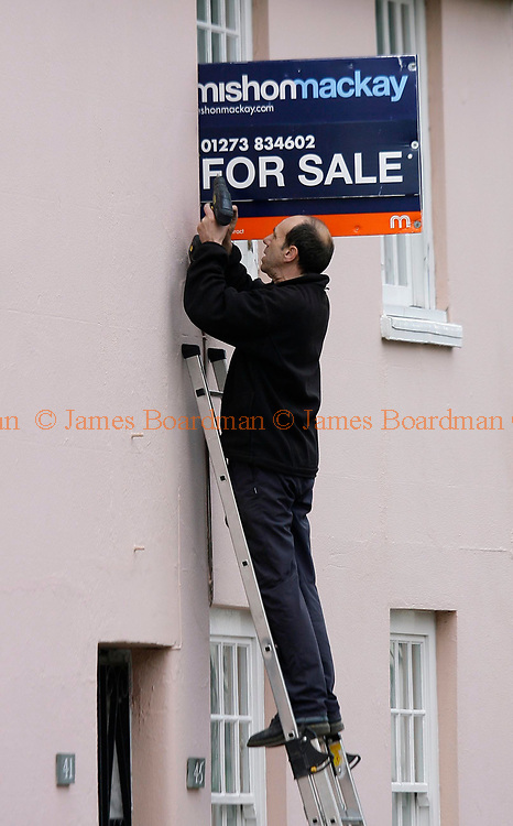 JAMES BOARDMAN / 07967642437<br /> House prices fell by 2.5% in March, the biggest monthly decline since September 1992, much more than many analysts had forecast, the Halifax has said. <br /> A man attaches a for sale board to a house in hurstpierpoint, West Sussex.