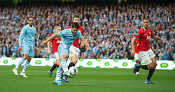 MANCHESTER, ENGLAND - Monday, April 30, 2012: Manchester City's Sergio Aguero in action against Manchester United during the Premiership match at the City of Manchester Stadium. (Pic by Chris Brunskill/Propaganda)