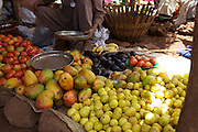 A lady selling fresh tomatoes and mangoes in a local market in Bahir Dah, Ethiopia.