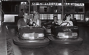 Teenage boys on dodgem cars, Ibiza, Spain, 1984