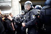 Frankfurt am Main   11 Apr 2015<br /> <br /> Am Samstag (11.04.2015) demonstrierten etwa 35 Personen der Gruppe &quot;Freie B&uuml;rger f&uuml;r Deutschland&quot; (FBfD, ex PEGIDA) auf dem Rossmarkt in Frankfurt am Main gegen &quot;Islamisierung&quot;, ihre Redebeitr&auml;ge gingen in dem Geschrei der etwa 800 Gegendemonstranten unter.<br /> Hier: Gegendemonstrant und Polizei.<br /> <br /> &copy;peter-juelich.com<br /> <br /> [Foto honorarpflichtig   No Model Release   No Property Release]