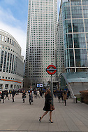 Young woman working in Canary Wharf, one of the financial districts of London.