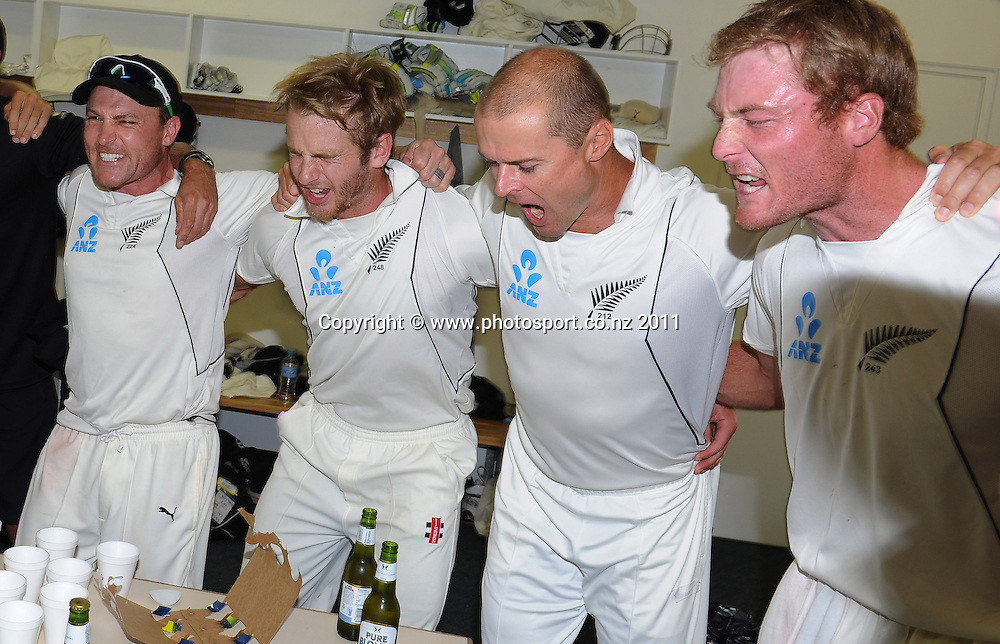 L_R Brendon McCullum, Kane Williamson Chris Martin and Martin Guptill singing in the dressing room after a famous win over Australia on Day 4 of the second cricket test between Australia and New Zealand Black Caps at Bellerive Oval in Hobart, Monday 12 December 2011. Photo: Andrew Cornaga/Photosport.co.nz