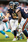 CHICAGO, IL - OCTOBER 22:  Mitchell Trubisky #10 hands off the ball to Tarik Cohen #29 of the Chicago Bears during a game against the Carolina Panthers at Soldier Field on October 22, 2017 in Chicago, Illinois.  The Bears defeated the Panthers 17-3.  (Photo by Wesley Hitt/Getty Images) *** Local Caption *** Mitchell Trubisky; Tarik Cohen