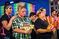Kyra and Crystal Murphy (left) stand beside Nicole and Kellie Edwards during the Equality Florida candle light vigil at Dr. Phillips Center, photo by Roberto Gonzalez Aftermath of the Pulse nightclub shooting in Orlando, Florida.
