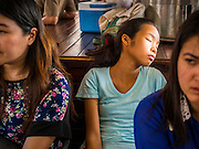 01 APRIL 2014 - BANGKOK, THAILAND:   A passenger sleeps on a Chao Phraya Express River boat in Bangkok. The Chao Phraya Express boats carry tens of thousands of passengers up and down the Chao Phraya River through Bangkok.   PHOTO BY JACK KURTZ