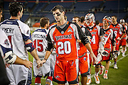 DENVER, CO - JULY 4: Jeremy Sieverts #20 of the Denver Outlaws shakes hands with Boston Cannons players after their MLL game at Sports Authority Field at Mile High on July 4, 2015 in Denver, Colorado. The Cannons won the game 22-9. (Photo by Marc Piscotty/Getty Images) *** Local Caption *** Jeremy Sieverts