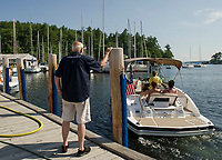 Merrill Fay sends off a boater from the gas dock at Fay's Boat Yard on Lake Winnipesaukee.  (Karen Bobotas/for New England Boating)