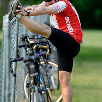 Clay Norris of Spirit Lake, IA stretches during a break Tuesday morning in Canova during the third day of the Tour de Kota.