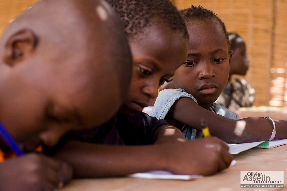 Children writing in their school books during class at the Tangory Transgambienne 2 primary school in the town of Bignona, Senegal on Wednesday June 13, 2007.