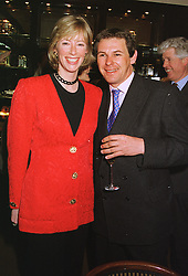 MRS ZARA PLUNKETT-ERNLE-ERLE-DRAX and her close friend MR CHARLES GORDON-WATSON, at a party in London on 11th February 1999.MOI 34