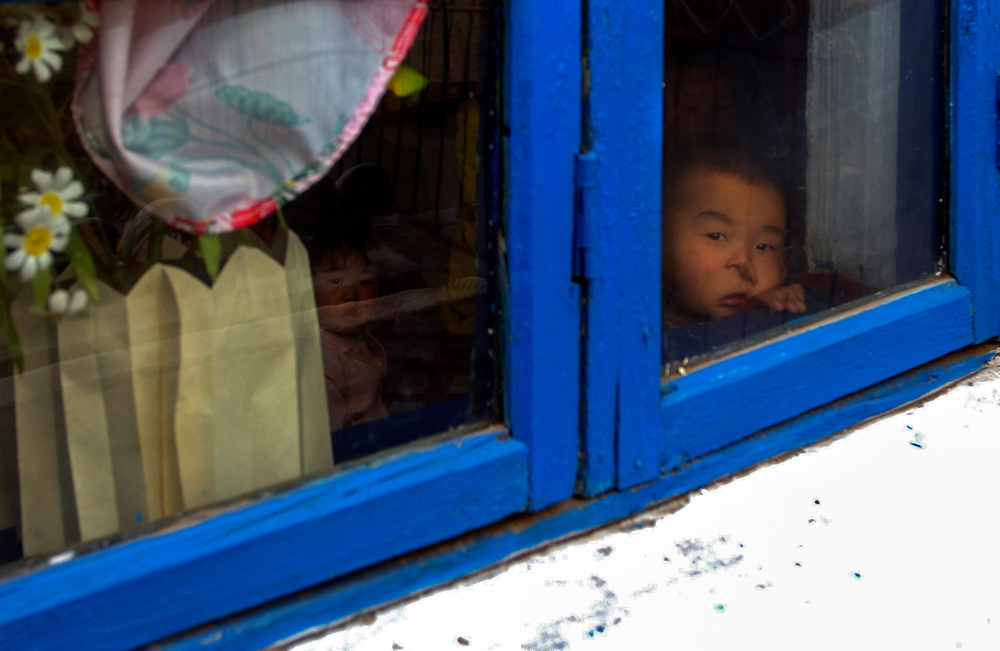 North Korea:<br /> North Hwanghae Province<br /> <br /> A young boy peers out of a nursery at Yonsan <br /> <br /> <br /> &copy;Jeremy Horner<br /> 15 Mar 2004